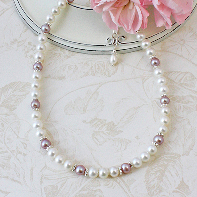Beautiful pearl necklace for girls in white and natural mauve pearls accented with sterling silver.