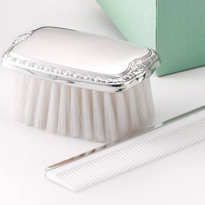 Sterling silver military style brush and comb set for baby boys. These beautiful baby gifts can be personalized with custom engraving.