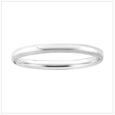Beaded edge silver bangle bracelet for children.