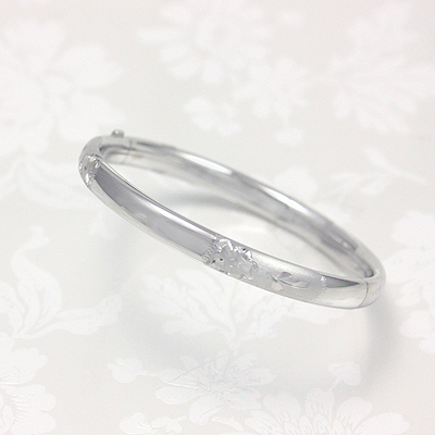 Silver bangle bracelets engraved with graceful floral pattern. Safety clasp. Size 6.25 inches