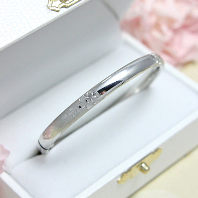 Sterling silver bangle bracelet with engraved floral pattern. Safety clasp. Child size 5.25 inches.