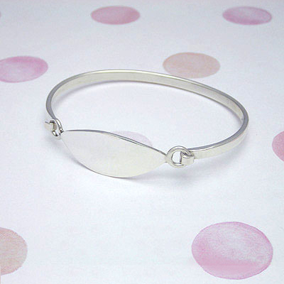Silver bangle bracelet with marquise shaped front personalized for kids. Children's size 6 inches.