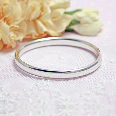 Polished silver bangle bracelet with safety clasp. These are child size 5.25 inch