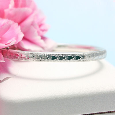 Sterling bangle bracelets for girls with border of raised hearts. Safety clasp. Size 6.25 inches