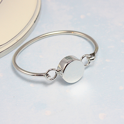 Silver bangle bracelet with puffed engravable medallion. Sized for baby and toddler. 4.5 inches