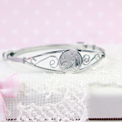 Guardian angel bangle bracelets in sterling silver. Adjustable sizing fits baby, toddler, and child.