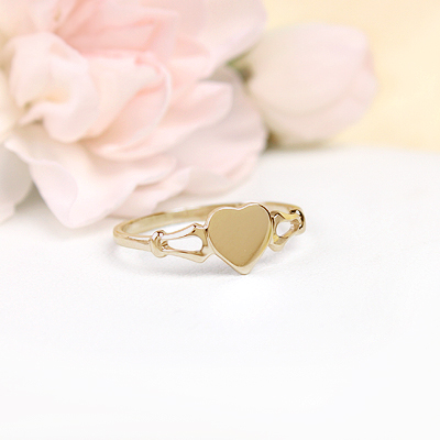 Girls 10kt gold signet ring with heart shaped front. Engraving is included on our signet ring.