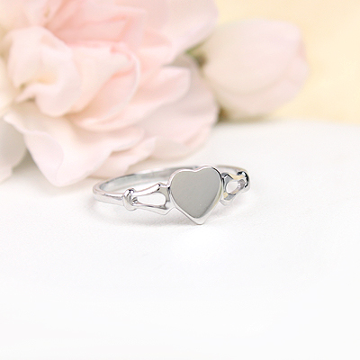 Girls 14kt white gold signet ring with heart shaped front. Engraving is included on our signet ring.
