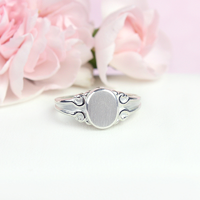 Signet ring for teens and adults in sterling silver. Our signet ring has an oval front and beautiful detailing; engraving included.