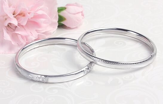 Baby and children's silver bangle bracelets in two designs.