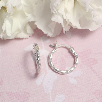 Silver twist hoop earrings for children and teens with click closure.