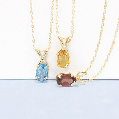 14kt gold birthstone necklaces for girls with genuine oval birthstones and accent diamond.