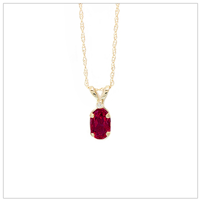14kt gold July birthstone necklace with genuine ruby and accent diamond; chain included.