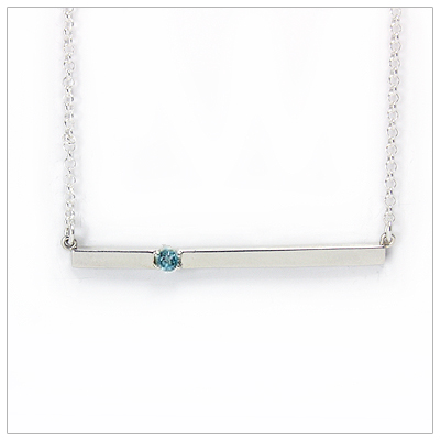 Chic sterling silver bar December birthstone necklace; sleek styling and genuine faceted blue topaz.