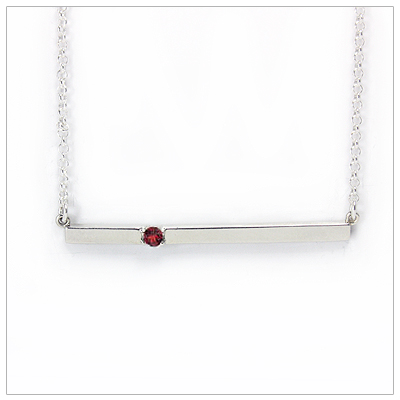 Chic sterling silver bar January birthstone necklace; sleek styling and genuine faceted garnet.