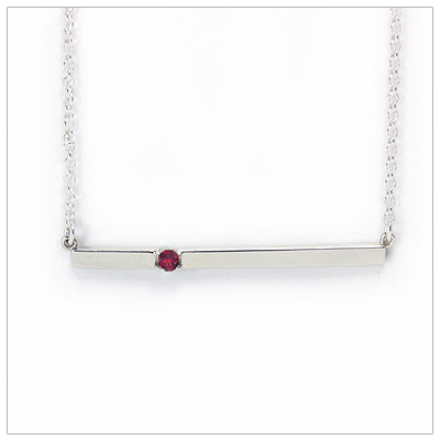 Chic sterling silver bar July birthstone necklace; sleek styling and genuine faceted ruby.