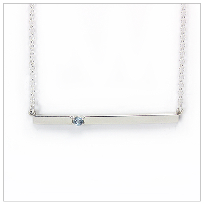Chic sterling silver bar March birthstone necklace; sleek styling and genuine faceted aquamarine.