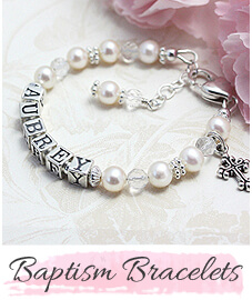 Baptism bracelet in white pearls, natural crystal, and sterling letter blocks.