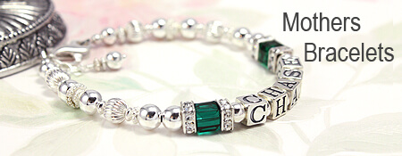 Silver mothers bracelet with cube crystal birthstones and sterling cz caps.